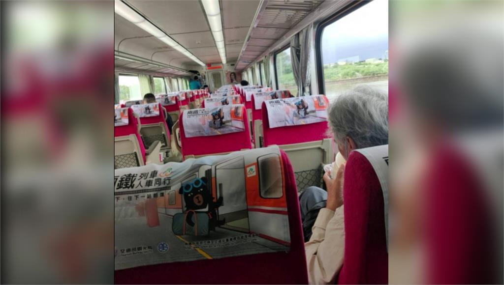 男子在列車上脫口罩飲食。圖/台視新聞